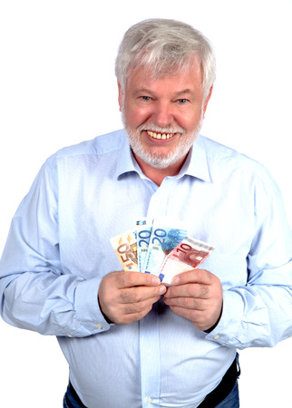 Pensioners keeps a Geldfcher in hand Stock Photo