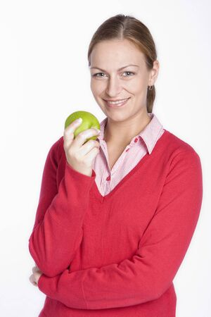 deliberately: woman is eating an apple Stock Photo