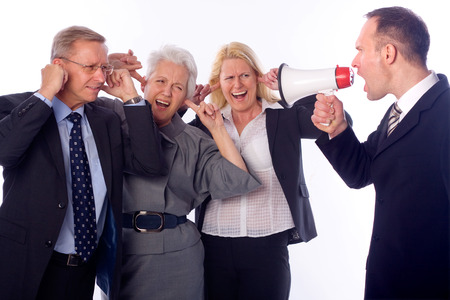 manager team: Manager shouting to his team with a megaphone Stock Photo