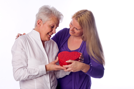 cordially: Daughter giving a gift to her mom Stock Photo