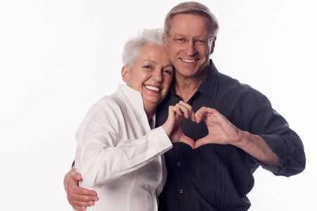 zest for life: Couple showing a heart with ther hands