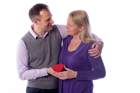 zest for life: Young couple holding a heart in there hands