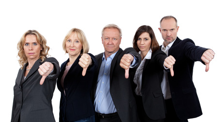 Gemengd team tonen duim omlaag Stockfoto