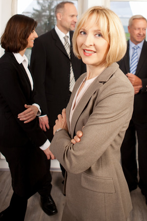 femal: Femal manager in front of her team Stock Photo
