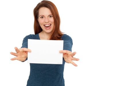 exempted female: Young smiling woman holding a blank white paper in her hands