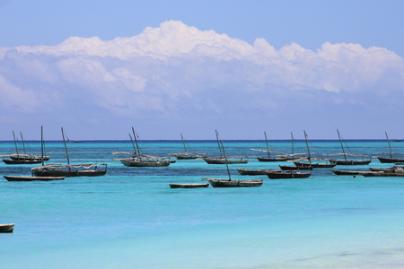 Fishing dhows in island harbour Stock Photo