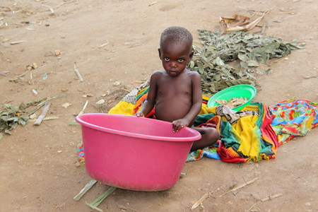 A young child plays in poverty stricken rural Mozambique Editorial