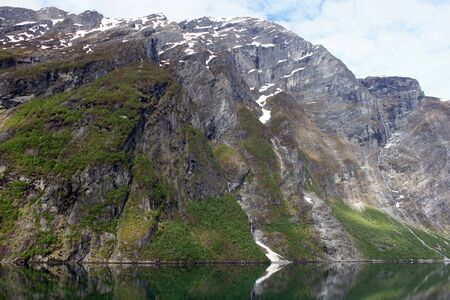 cliff face: Cliff face with glaciers above a fjord Stock Photo