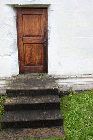 excluded: Steps leading to a closed wooden door