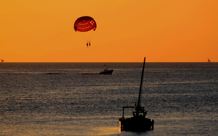 hanging around: Just hanging around on holiday - couple on a parasail