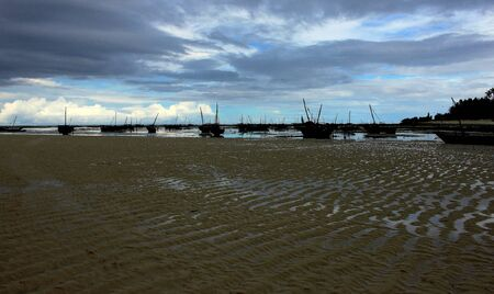 Fishing dhows silhouette at low tide photo