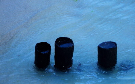 unyielding: Three firmly grounded mooring poles