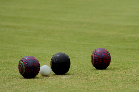 biased: wooden balls used in the game of bowls Stock Photo