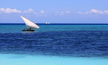 subsistence: Dhows sailing on an azure sea