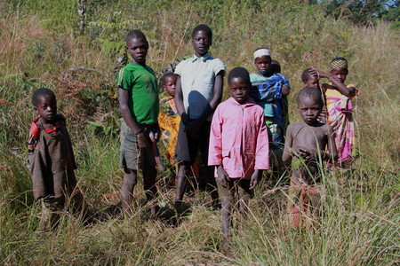 impoverished: Rural living - village children in Mozambique Editorial