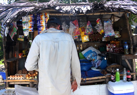 informal: Tourist buys supplies from an informal roadside store in rural Mozambique