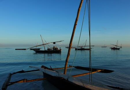 subsistence: Rural living - fishing dhows in Nungwi Village harbour, Zanzibar