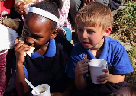 underprivileged: Poor school children being fed in winterGauteng South Africa