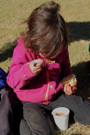 underprivileged: Poor school children being fed in winter Gauteng South Africa 2015