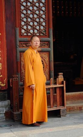 delusion: Buddhist monk outside temple Xian China
