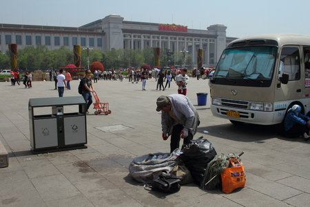 destitute: Homeless man collect plastic on Tiananmen Square Beijing China