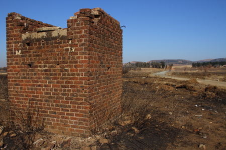 gauteng: Abandoned building next to dirt road Stock Photo