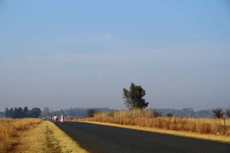 gauteng: Women walking home in rural South Africa