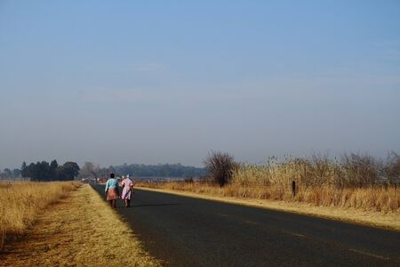 gauteng: Two women walk home from work in rural South Africa