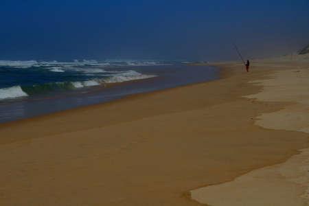 lone: Lone angler fishing on the beach