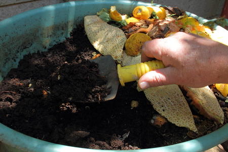 Harvesting compost from a residential earthworm farm Stock Photo