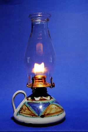 oil lamp: A glass oil lamp giving off soft light