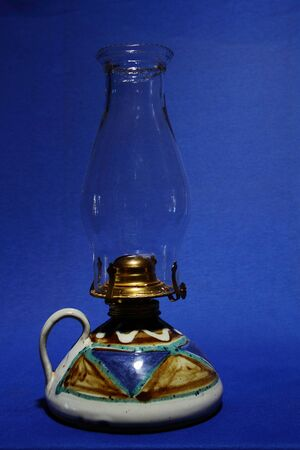 oil lamp: A ceramic oil lamp
