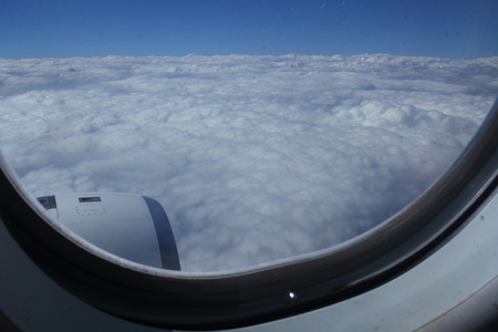 window view: View of the clouds through an aircraft window