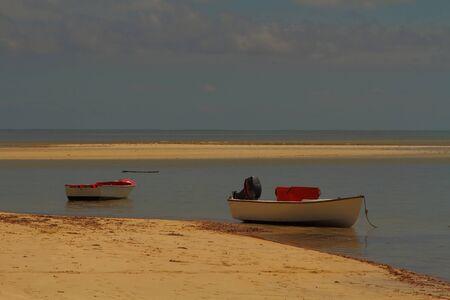 sandbank: Small fishing boats moored on a sandbank on the beach