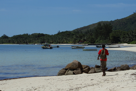 subsistence: A fisherman arrives at the fishing boats in the bay