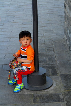 Little girl with handbag Beijing China Editorial