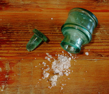 messy kitchen: Coarse sea salt spill from a container