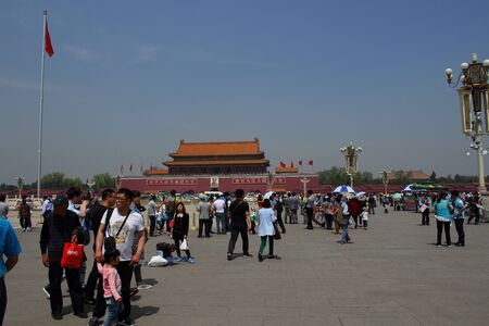 holidaymaker: Tourtists gather on Tiananmen Square Beijing China