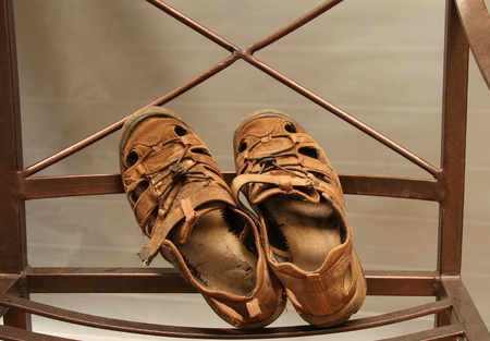 A pair of old, worn sandals