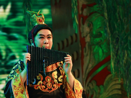 pan flute: Bamboo pan flute being played by a Chinese flautist Editorial