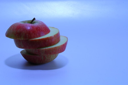 stacked: Stacked, sliced red apple