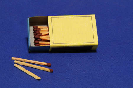 no fires: Matches on a blue background - one match not usable Stock Photo