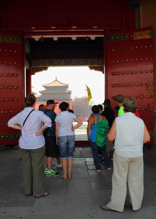 polygamy: Western tourists at the doors to the Forbidden City Beijing China