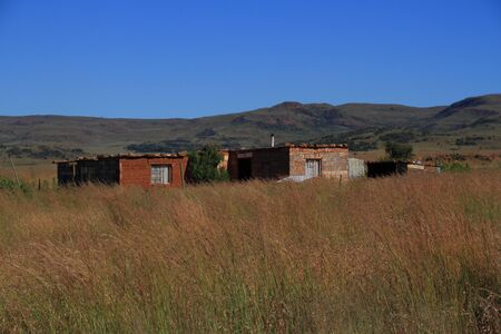 small houses: Small houses in the grassland on Gauteng Highveld Stock Photo