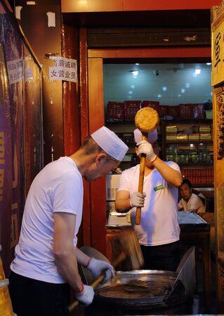 sweetmeats: Chefs preparing sweetmeats Muslim Quarter Xian China