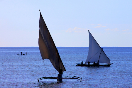 modes: Modes of water transport - dhow, outrigger and dugout canoe