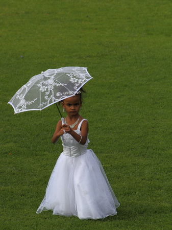 flowergirl: Little flower-girl with umbrella Editorial