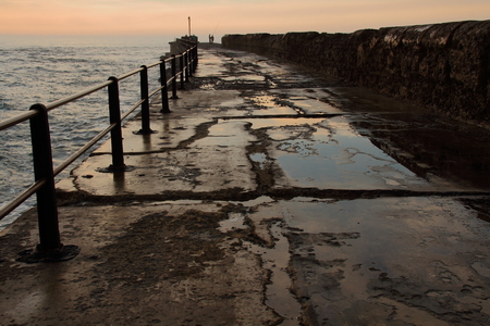 weathered: A weathered breakwater