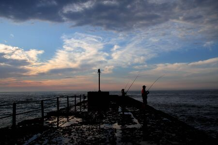 early: Early morning anglers Stock Photo