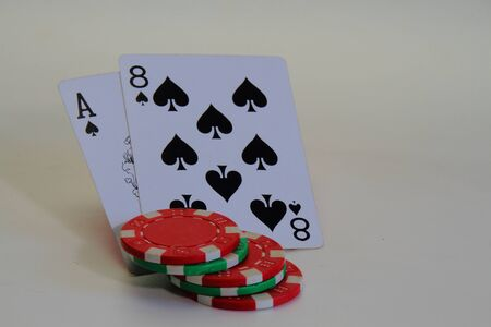 eights: Playing cards and gambling chips